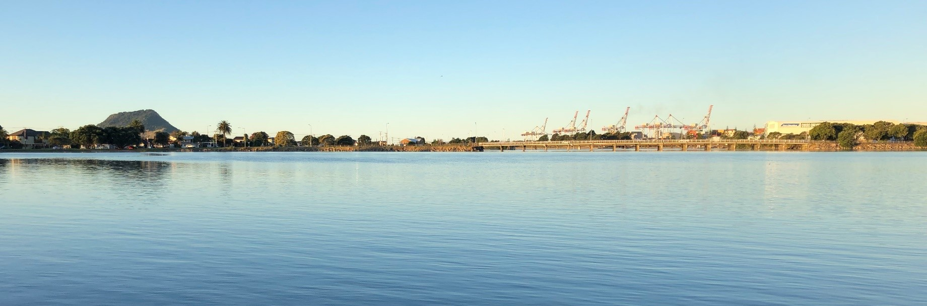The Mount and Tauranga Port from the Strand on a beautiful calm morning